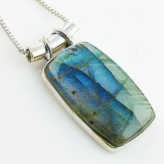 """Labradorite Solid Sterling Silver pendant. DETAILS: * Labradorite Pendant * 5.7 g total weight * Set in SOLID .925 Sterling Silver & Brass * Stamped .925 * Measures approximately 3/4"""" x 1 1/2"""" includi"""