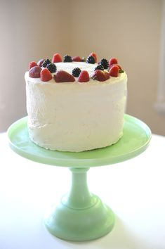 Triple Berry Cake with Whipped Cream frosting. Might just do this for Meredith's cake and add on a Minnie/Mickey topper. Sounds so perfect for summer!