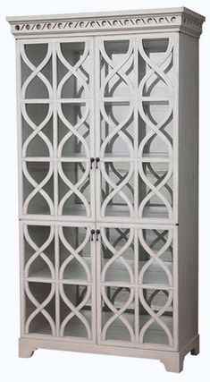 White Painted Cabinet with Glass Lattice Doors Non Antiqued Mirrored Back One Fixed Shelf and Three Adjustable Shelves Finishes Available: Antiqued White, Chalk, Dark Brown Interior Top:42