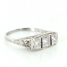 Pre-Owned Antique Art Deco Platinum 3 Stone Diamond Sapphire Filigree... ($895) ❤ liked on Polyvore featuring jewelry, rings, platinum, platinum ring, art deco sapphire ring, diamond rings, antique filigree ring and graduation rings