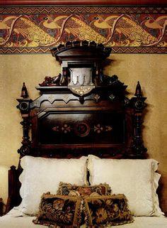 Renaissance Revival bed against wallpaper with a Walter Crane frieze.