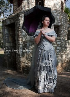Bride Portrait 1 | Aiko posing by the pigeon cote at Mayfield Park and Preserve in Austin. Victorian ball gown based on fashion plate from 1879. Antique parasol frame with carved wooden handle, recovered with silk brocade in lavender and plum, trimmed with black fringe. Sewn by Christine Hall.