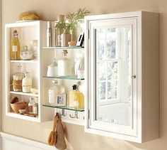 Going with two mirrors on either side and the glass shelves in the middle.  In white.