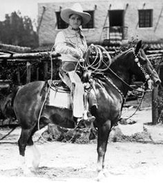 """Tom Mix (1899-1942) and his Wonder Horse """"Tony"""".  First horse was """"Old Blue"""". Made 336 films and gave John Wayne a job working on the back lots at Universal Pictures after Wayne's football career ended.  """"Tony"""" was named in Tom Mix's obituary and his hoofprints are along side Tom's in Hollywood."""