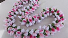 The lei is approximately 36 inches long material/satin ribbon,/organza ribbon
