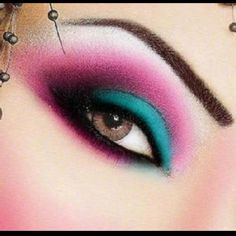 Teal and magenta makeup for mad hatter
