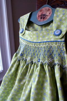 Smocking.  Love the colors and the dress design