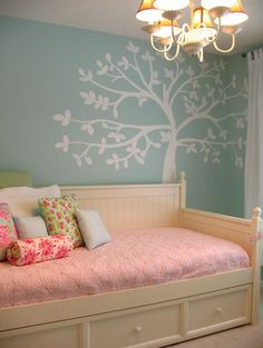 Just a Girl traditional kids: Such a cute feature wall for a little girls room. And it's nice to see blue walls in a girls room. It doesn't have to be all pink but it's still girly with the flowering tree and the floral pink accessories.