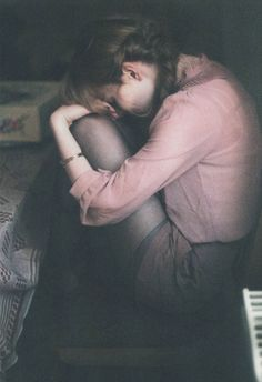 She cried into her knees like her heart was breaking. She couldn't take all the taunting anymore.