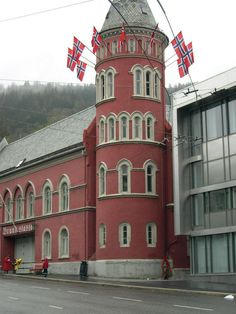 Syttende Mai and Norwegian flags on a fire station.