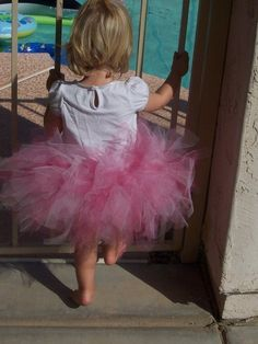 I used this Tutu Tutorial to make part of Bella's Halloween costume.  Easy to follow, very minimal sewing (I did by hand), and the tutu turned out great!!!