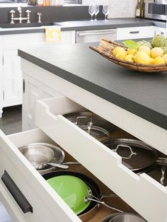 Kitchen drawer storage for pots with an inner drawer for lids - great idea!
