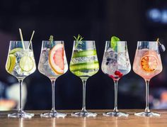 Photo about Five colorful gin tonic cocktails in wine glasses on bar counter in pup or restaurant. Image of drinks, party, environment - 111478962 Champagne Cocktail, Signature Cocktail, Cocktail Drinks, Cocktail Recipes, Cocktail Movie, Cocktail Sauce, Cocktail Attire, Cocktail Shaker, Cocktail Dresses
