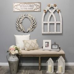 """Create a warm and inviting look in your home with the White Arch with Metal Flowers Wall Decor. The beautifully handcrafted design seems inspired by traditional farmhouse style. A distressed white finish and a small spray of gold-finished brown faux leaves at top complete the charming look superbly. Hang this as a stunning standalone centerpiece on a wall or mix it with other rustic accents to create a real custom display. It comes ready to hang and measures 19.75"""" W x 1"""" D x 28.25"""" H. Arched Wall Decor, Entryway Wall Decor, Family Wall Decor, Farmhouse Wall Decor, Farmhouse Style, Rustic Farmhouse Entryway, Small Wall Decor, Accent Wall Decor, Cottage Farmhouse"""