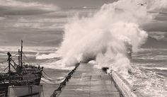 A wave breaks over Kalk Bay harbour wall in False Bay, Cape Town, South Africa 26 October 2009. EPA/NIC BOTHMA