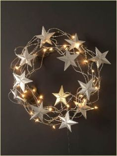 #gifts #christmas Cool barb wire wreath with punched tin stars -- handcrafted in New Mexico by Drew Coduti and Kevin Burgess of BC Designs