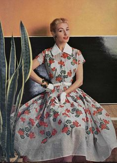 Model wearing a floral dress by Christian Dior, 1954.