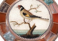 A gold mounted Steinkabinett circular bonbonniere set with a micromosaic plaque, unmarked, by Johann Christian Neuber, Dresden, the micromosaic, workshop of Giacomo Raffaelli, Rome, circa 1790 - Giacomo Raffaelli (1753-1836) came from a family who worked for the Studio del Mosaico della Fabbrica della Basilica di S. Pietro in Rome. He is credited with many of the innovations in mosaici in piccolo , although it is probable some had been developed a little earlier.