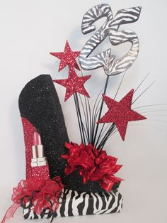 One of our most popular birthday centerpieces are the one with a high heel shoe. Are you a Diva who loves, shoes, bling and zebra print, this centerpiece is for you. No matter what age birthday we …