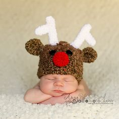 Baby Reindeer Hat.  I think beanies and caps are way cuter for babies than those silly headband things