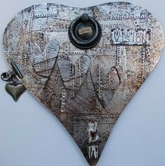 """Mixed media project.  shape covered with patchwork of metal foil tape. emboss pattern.  add smaller shapes. """"age"""" with paint rubbed off.  add embellishments to complete the theme.  Riveted Patchwork from Compendium of Curiosities II by Tim Holtz- need to find the book"""