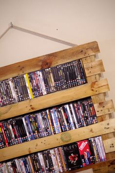 Pallet wood DVD rack made from an American pallet, wall mounted using rope.