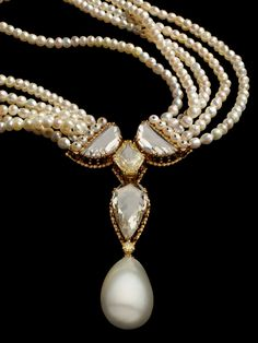 Alexandre Reza natural pearl necklace set with a pear-shaped pearl, a fancy intense yellow diamond and 3 rose-cut diamonds.