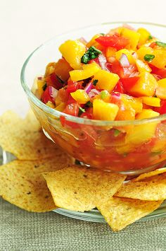 Peach Salsa made with ripe, intoxicating fresh peaches - enjoy this with sprouted-grain pitas, on top of chicken or fish, or just by the bowlful! Sub xylitol (or drops of stevia) for the sugar. Peach Salsa Recipes, Fruit Recipes, Summer Recipes, Mexican Food Recipes, Appetizer Recipes, New Recipes, Cooking Recipes, Favorite Recipes, Appetizers