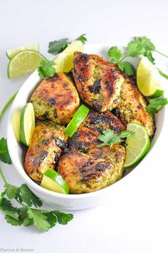 Easy Thai Baked Chicken made with cilantro, jalapeño, ginger, basil, garlic and coriander and garnished with lime slices
