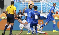 Uruguay\'s Martin Caceres is tackled by Italy's Marco Parolo during their 2014 World Cup Group D soccer match at the Dunas arena