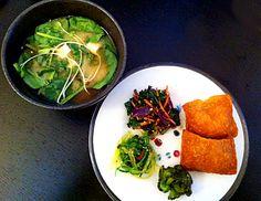 miso soup with tofu, spinach, radish sprouts. seaweed salad, japanese pickles, rainbow kale salad with furikake,   inari.