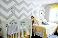 This yellow and grey babies room is GORGEOUS!