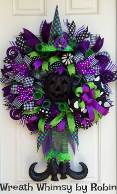 Deluxe Halloween Fancy Witch Wreath in Lime, Purple & Black.  This stunning XL witch wreath would make a marvelous addition to your holiday decor. The eye catching colors really stand out and it is full of designer ribbon and embellishments.  This wreath is constructed with a premium wide foil deco mesh in purple and layered with rolls of mesh in green and a green/purple/black plaid mesh. The witch legs/skirt and hat are hand sewn by a wonderful designer. Surrounding the wreath are 32 ribbon…
