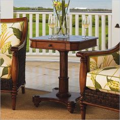 British Colonial Style - dark woods, detailed carving, cream color w/ green accents.