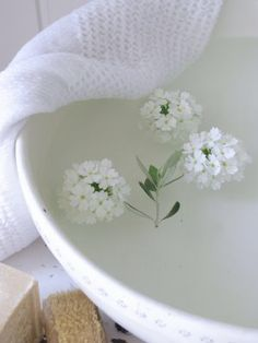 Freshly cut flowers added to a warm water in a wash basin make a deliciously soothing foot soak.