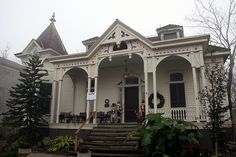 """""""the cottage""""  Built about 1882 , late greek revival, high victorian detail,  gingerbread trim, ornate towerHas survived many storms, including the 1900 Storm."""