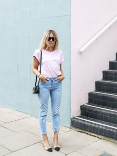 The perfect French girl weekend look—an embroidered tee, raw hem jeans, and cap-toe heels.