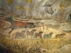 "The ""Falling Cow"" and ""Frieze of Small Horses"" beneath the outline of the head of an aurochs demonstrate the diversity of color and technique utilized in the cave, in this image from Lascaux II. Photo Credit: APPI / SEMITOUR"