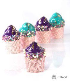 mirror glaze cupcakes decorated with unicorn graffiti sprinkles