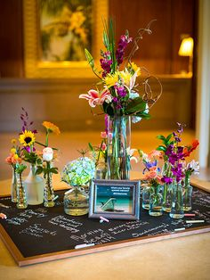 Have your guests write their Emmy predictions and fashion comments on this pretty chalkboard centerpiece. (Via PEOPLE Great Ideas)