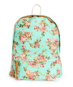 This medium size backpack has a floral print canvas exterior with exposed zippers, and plenty of storage space perfect for storing all of your essentials.