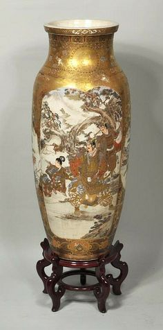 "Japanese porcelain Satsuma palace vase, 19th century, on wood stand. 36"" high, 14"" diameter."