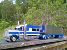 Peterbilt with extended sleeper and reefer trailer