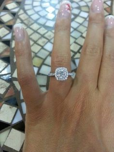 With a round center diamond. Love the skinny halo and skinny band.