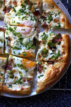 Breakfast pizza with mozzarella, bacon, eggs, and lots of fresh herbs