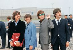 The Beatles, just off the airplane, during their U.S. tour in August 1965.