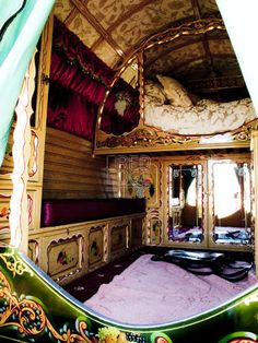 gypsy caravan...this would be a great design in an rv...I wonder if those glass doors hide a clothes closet...that would be awesome!