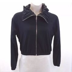 Bebe sport black super cute zip up large Bebe Sport jacket/sweatshirt Women's size Large Very interesting and unique design with chiffon trim under the arms, sides and neck.  Full zip up the neck creating a cowl/turtle neck style, or a fun open style. Black throughout 94% Cotton 6% Spandex Measures approximately: Bust 42 inches, length 18 inches Very good pre-owned condition with only minor signs of use. Lots and lots of life still left! No visible defects such as holes or stains.  #656-55…