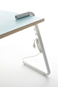 Italian design studio Mandalaki introduced a table concept that aims to easily accommodate digital devices. Their design is essentially a power-strip reshaped to become a table leg. Integrated into the bent steel tube are traditional power outlets and several USB ports for charging mobile devices. A variety of table top sizes can be used and assembly is done without any hardware or fasteners.