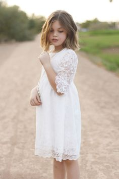 She is beautiful but her looks never stood a chance compared to how breathtaking her soul is. #bsteelephotography #kidmodel #childmodel #phoenix #arizona #militarychild #flowergirldress #shorthair #blueeye